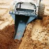 Stump bucket attachment for skid steers